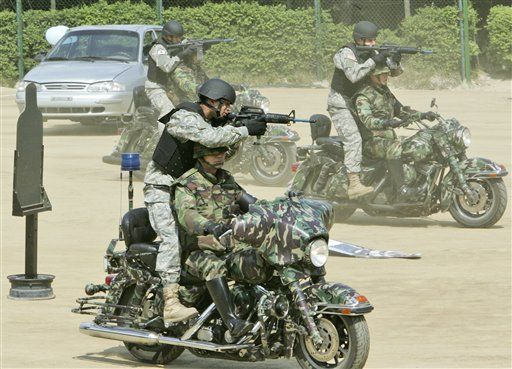 US soldiers operating from military Harley Davidson motorcycles .