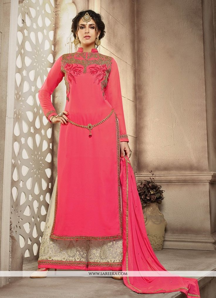 Women magnificence is magnified tenfold in such a rose pink georgette designer palazzo salwar suit. The lovely embroidered and resham work a substantial attribute of this attire. Comes with matching b...