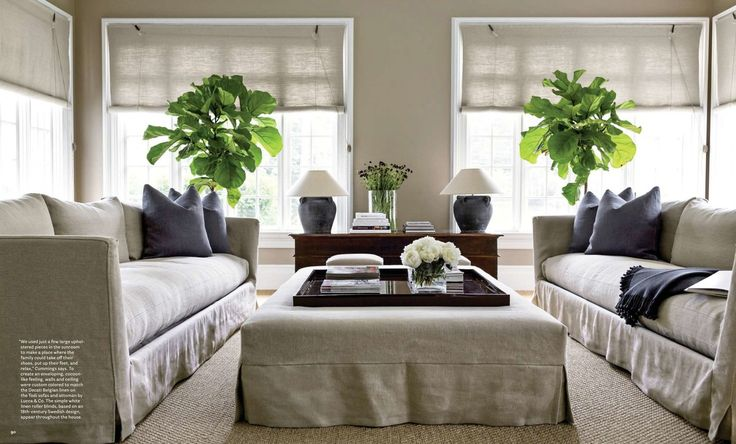 Sunroom Designs. Contemporary furniture set interior sunroom with double large grey sofas and center table, nice twin greenery decorations, wooden living room desk, and vintage dark grey table lamps. Warm Refreshment Inside; Cool Decorating Ideas For Interior Sunrooms