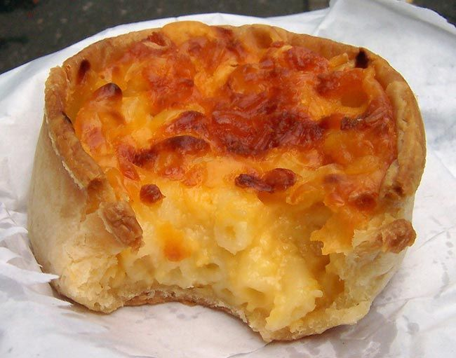 A Scottish macaroni pie, as opposed to a West Indian macaroni pie is a pie case made from hot water crust pastry, that is filled with macaroni cheese..