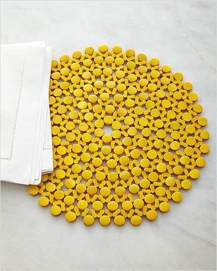 Kim Seybert Round Bamboo Yellow Placemat (Set of 4): Add a dash of color and dimension to your table with these brightly hued placemats by Kim Seybert! Crafted of lacquered bamboo disks in airy mosaic pattern. 15