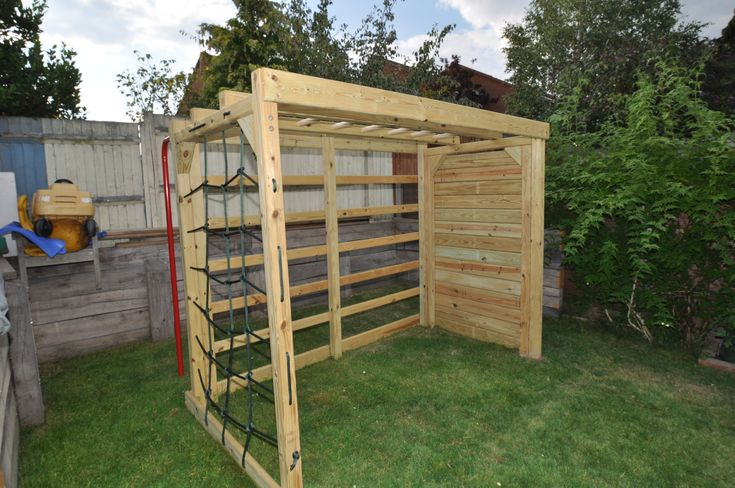 2 ideas in one - a climbing frame with the side open to act as goal for back garden footballers