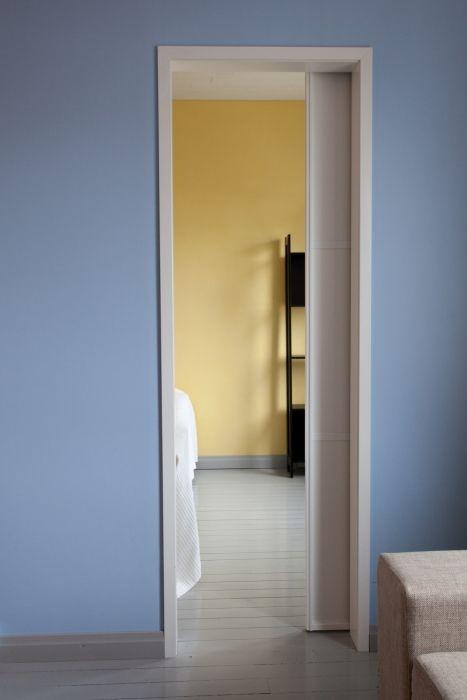 Tilanjakaja-likuovi säästää tilaa verrattuna ulospäin avautuvaan oveen.