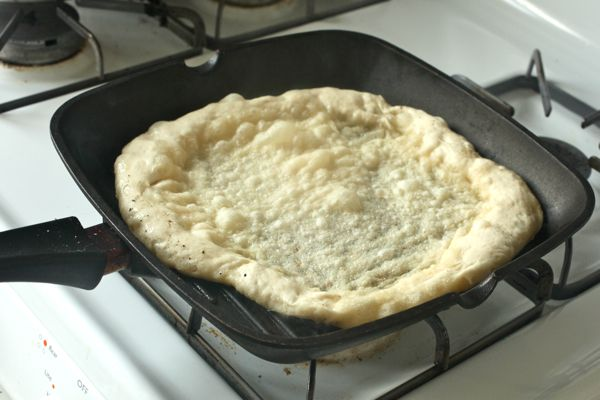Grilled pizza with a grill pan