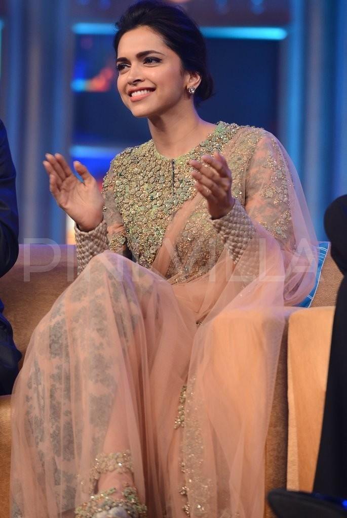 Deepika Padukone in Sabyasachi's sheer sari with a floral patterned underskirt.