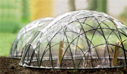 How to make a cloche for seeds using hanging baskets and heat shrink plastic film.