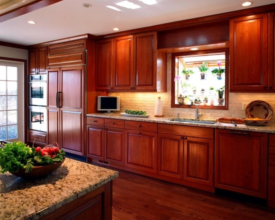 Kitchen cherry cabinets design pictures remodel decor for Updated galley kitchen photos
