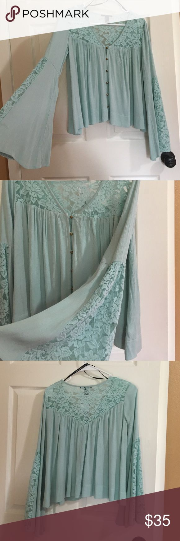 NEW BOHO LACE MINT TOP BELL SLEEVES Brand new. Beautiful BOHO TOP in mint. Fits XS and small and medium. Stretchy meant to fit loose. Beautiful LACE design on chest back and sleeves. Retails $45. Price firm. Posh takes a fee. Liquidation prices reflected 🎁☺️ ships fast! 5 star seller! Not fp but same quality. ☺️🎁 Free People Tops