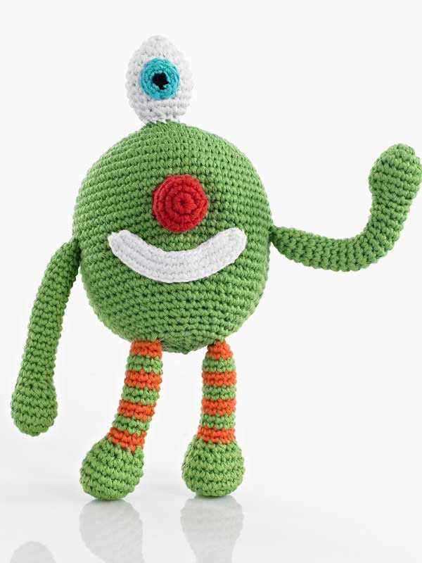Monster Rattle from Shopping for a Change -  $16.00 USD -   100% Cotton Yarns, 100% Polyester fill. Hand knitted and crocheted. Cuddly and fun. No sharp edges. Machine washable in warm water, tumble dry low setting. Meets all U.S. Consumer Product Safety Regulations.
