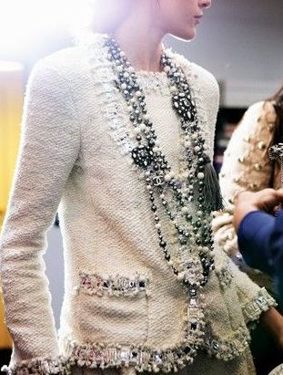 White boucle jacket. I love the style and the pearls are AMAZING.