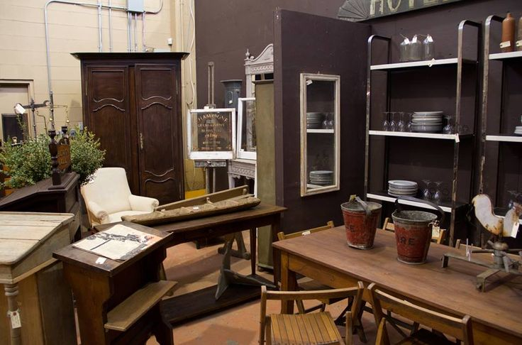 Antique French kitchen table and vintage shelving racks.