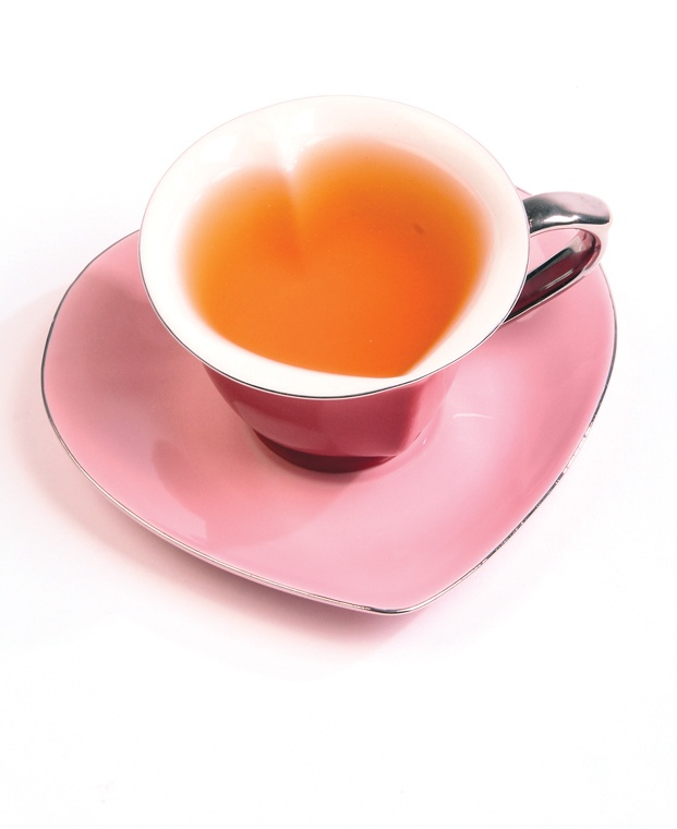 heart-shaped cup and saucer