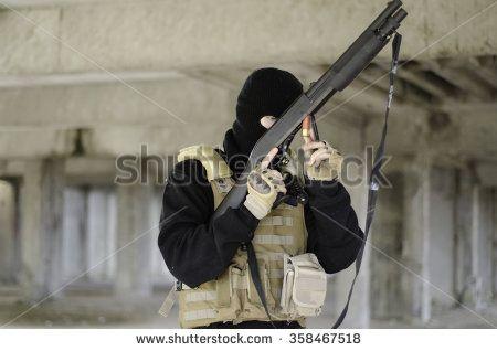 Terrorist mask shotgun - stock photo