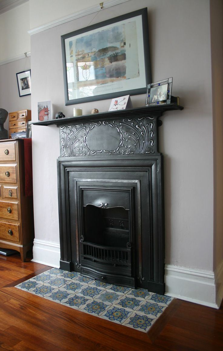 Cast iron Art Nouveau bedroom fireplace. The detail has been polished.