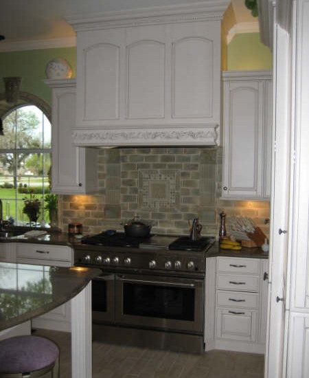 Traditional brookhaven white kitchen with natural stone for Decorative millwork accents