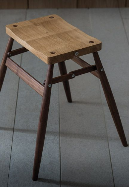 Imo Folding stool by Pinch Design Imo folds down through its centre, allowing it to be wall mounted using the supplied walnut peg. Dimensions: 450w x 410d x 475h