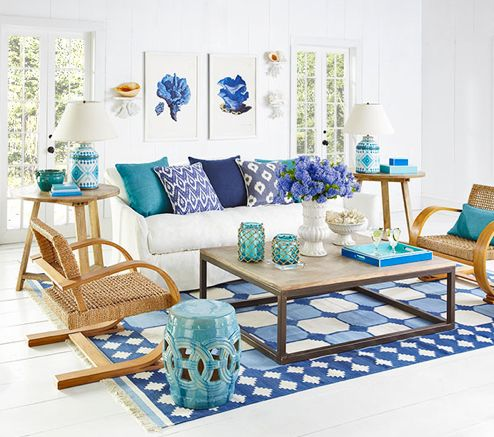 The pattern is terrific and the shades of sky blue and cobalt blue create the perfect combination. The catalog uses the rug in a coastal-inspired space with turquoise to great effect. I would love to combine it with lavender and green.
