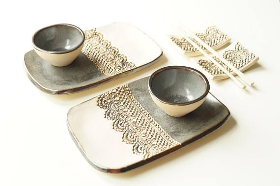 An original art set for sushi service - This listing is for a 6 pieces ceramic service set that includes two plates, two soy sauce dishes (bowls) and two chopstick rests. This is a fantastic wedding or holiday gift for someone special who enjoys food. This set has been formed from white clay and covered light beige and gray glaze. Gold Lace Pattern. Dimensions approx: Plates 8 x 5 Soy dishes (bowls) 3 by diameter Please do not hesitate to contact me with any questions or to discuss a cust...