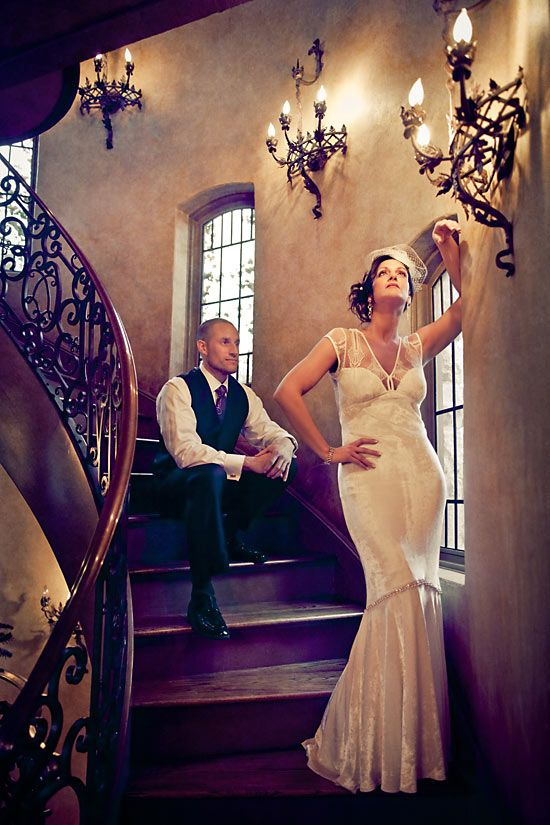 dramatic bride and groom pose at staircase good for any era.