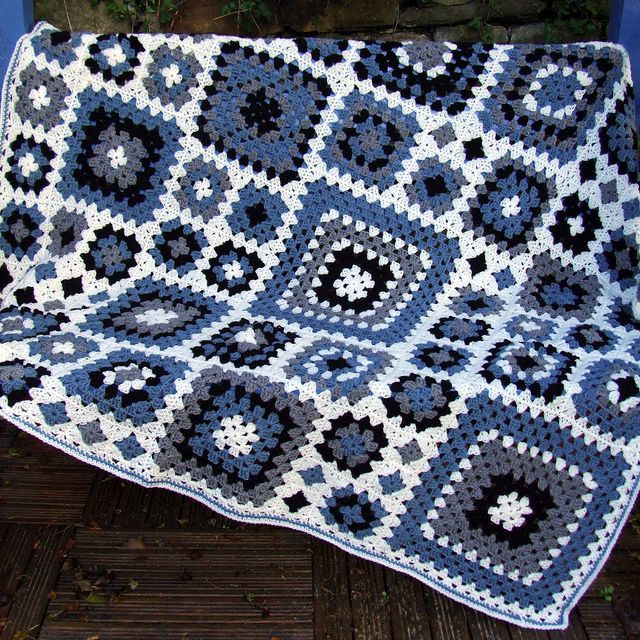 I am saving this for the idea of using different size granny squares in a blanket.  This of course, could be any color combo of 4 of your choosing.