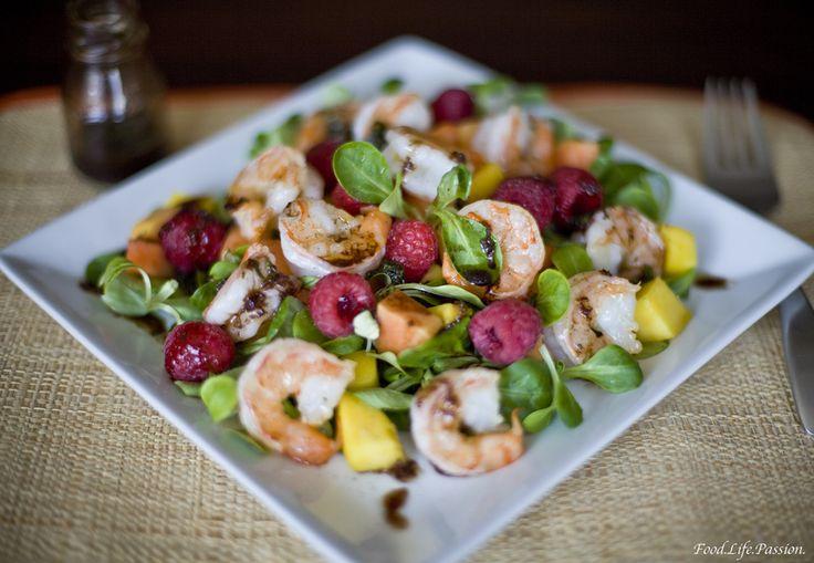 Shrimp, mango, papaya, raspberry salad. Summer eats!