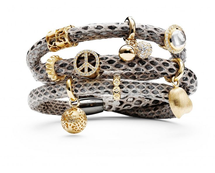 Layering the 'Story' bracelets is a great look.  Change the buttons and charms for a fun look.