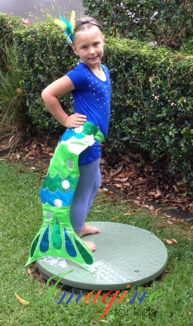 A beautiful mermaid wearing a green mermaid tails with blue and dark green accents.  To order contact Imagine For Kids  Email: sales@imagineforkids.com.au www.fb.com/imagine4kids