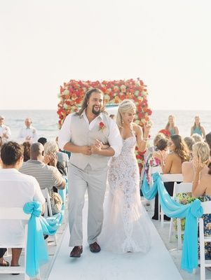 CJ 'Lana' Perry and Miroslav 'Rusev' Barnyashev walking up white aisle wedding ceremony beach Malibu