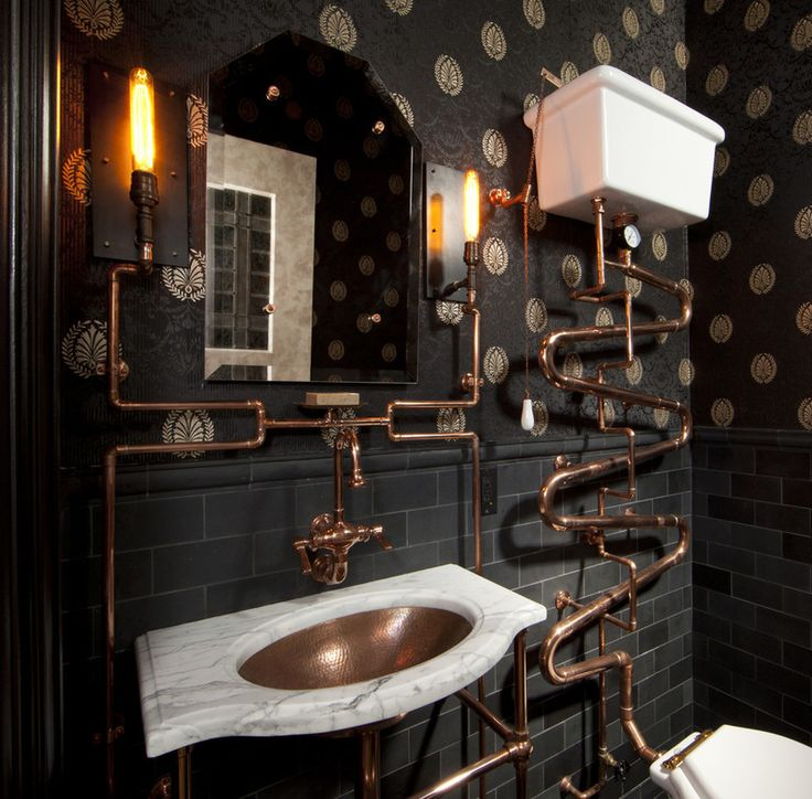 Exposed copper piping, dark subway tile, marble vanity eclectic bathroom by Andre Rothblatt Architecture