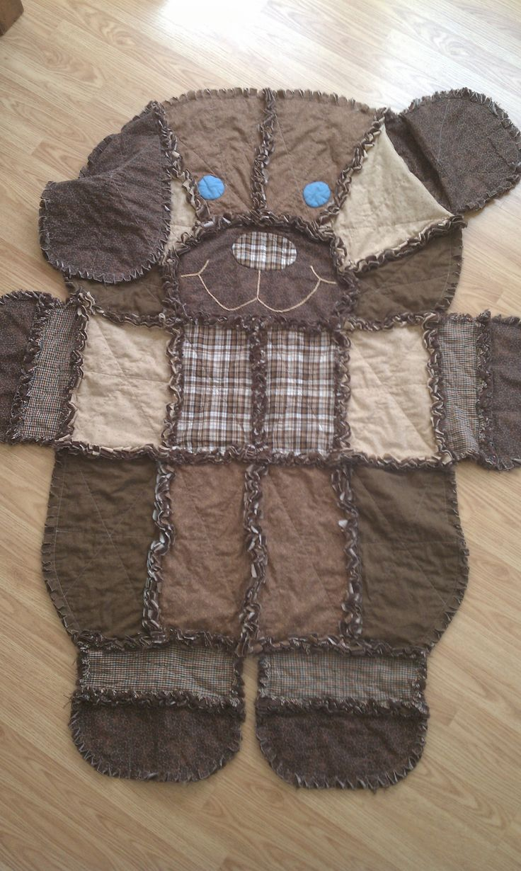 $65.00 Rag Quilt Dog is made of 100% cotton fabrics and makes a great gift for any little boy.