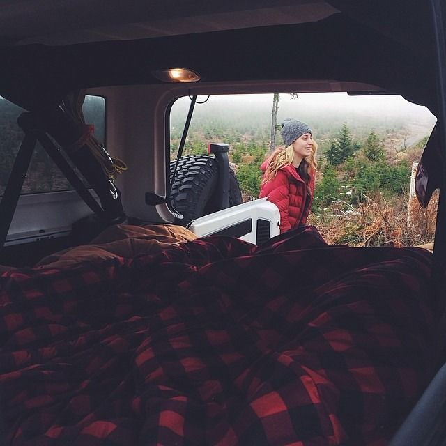 Spend the night in the truck of a car while camping...