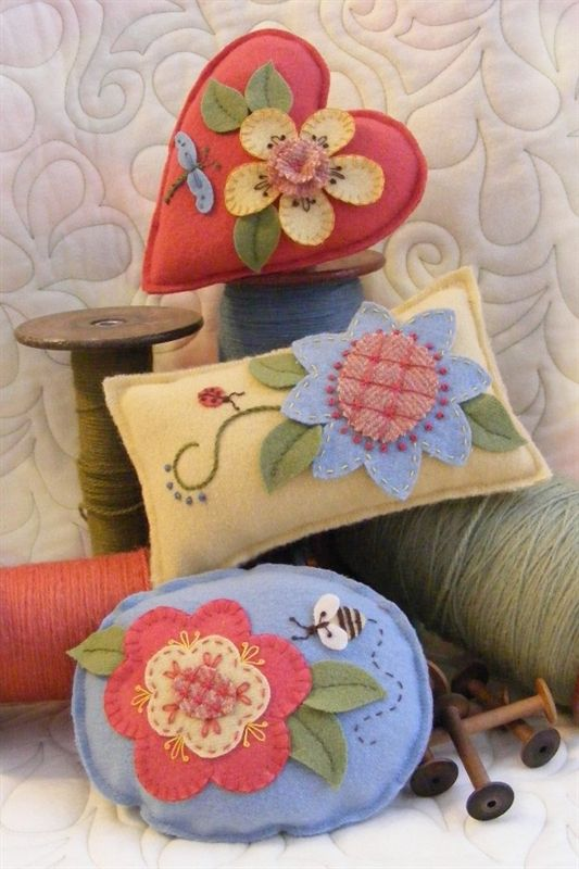 Three Wool Applique Pin cushions with Unique Flowers in Beautiful Shades of Wool.