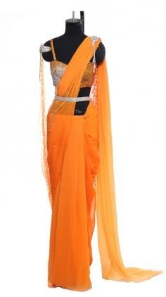 Crisp Orange Saree Raakesh Agarvwal combined with a beautiful orange embroidered blouse.    Indian designer Raakesh Agarvwal concentrates his designs on glamorous, opulent, rich and complex garments in the categories Indian couture and ready to wear . Strand of Silk (strandofsilk.com) offers a gorgeous selection of Indian wedding ouftis: Bridal Sarees, Wedding Lehengas and Indian dresses designed by one of India´s most notable designers Rakesh Agarvwal.