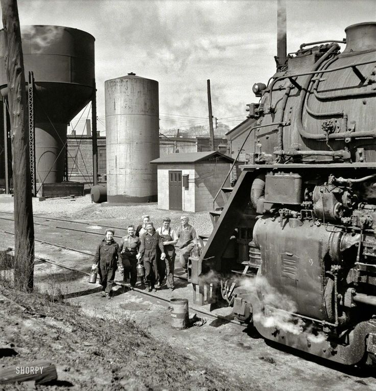May 1943. Clinton, Iowa. Women wipers of the Chicago & North Western Railroad going out to work on an engine at the roundhouse