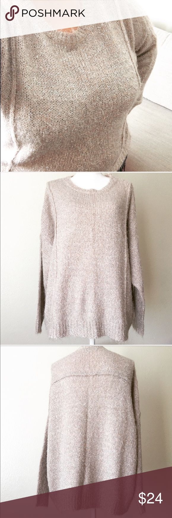 """Jennifer Lopez metallic oversized cozy sweater Jennifer Lopez pullover sweater, soft and fuzzy acrylic/nylon/metallic/poly blend, has a blush pink undertone with silver metallic threads. I tried this on, and absolutely love it, but it's rarely cold enough for a sweater here. Hopefully someone else will love it and enjoy it! In excellent condition, is an oversized XL but could fit up to a 2X, I am a plus size 20 (see modeled pic). Approximate measurements: bust = 54"""" length from shoulder…"""