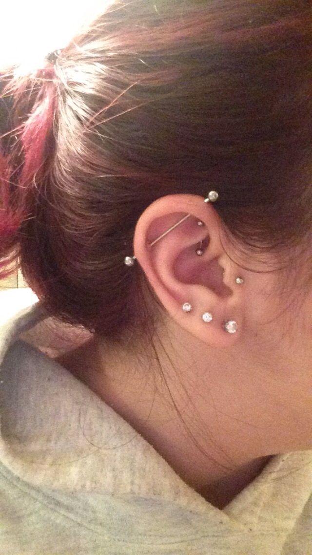 My left ear. Triple lobe, tragus, rook, and industrial piercings (: