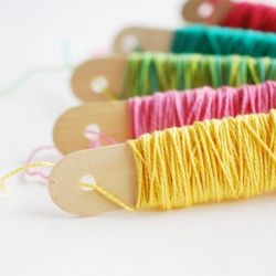 Keep your pearl cotton tangle-free with this simple storage solution!  Jumbo craft sticks (tongue depressor size!)