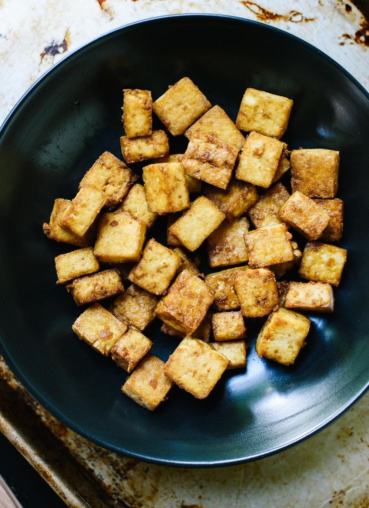 Learn how to make super crispy tofu (without deep frying!) at cookieandkate.com