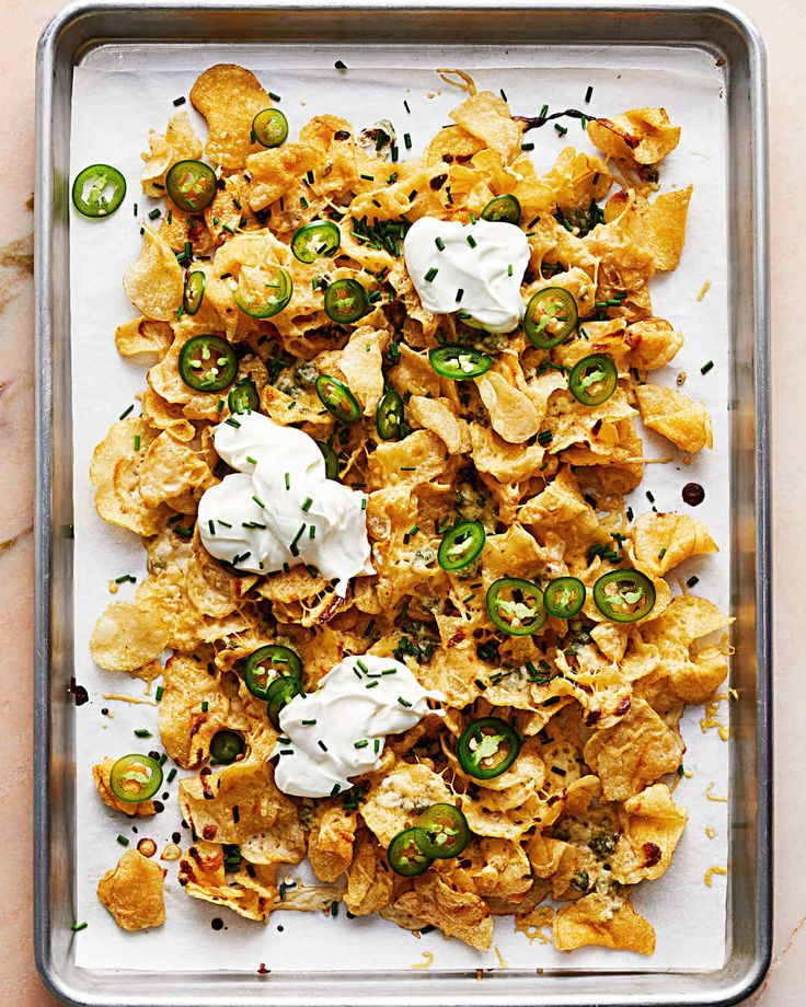 Kettle Chip Nachos | Martha Stewart Living - We've swapped out tortilla chips for kettle chips and cheddar for gouda and blue cheese in this deliciously unorthodox take on the classic.