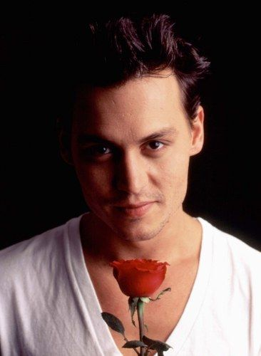 Aw, sure Johnny; I'd love a rose!