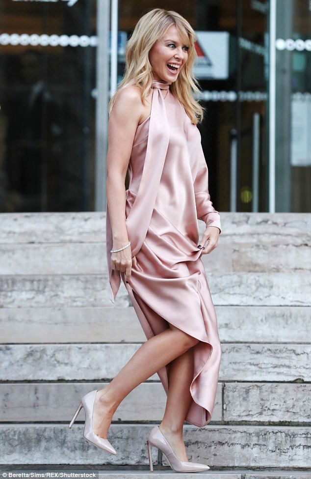 Stunning: The Australian singer showed off her enviable figure in the dress, which skimmed...