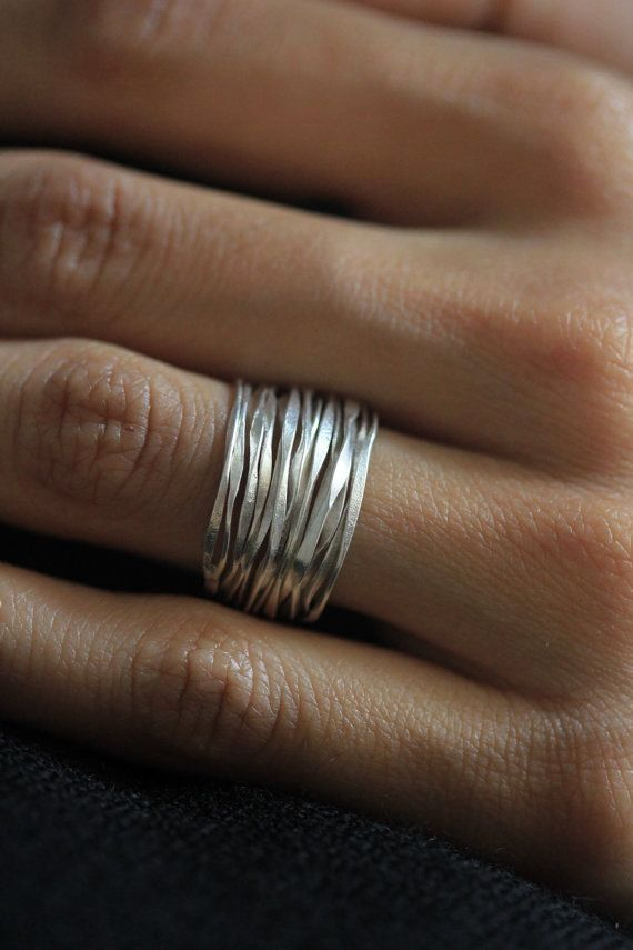 http://www.jewelrycluster.com/sterling-silver-jewelry-mystique-intrigueHandmade Hammered Silver Wire 98% silver ring size 6-7. $29,85, via Etsy.