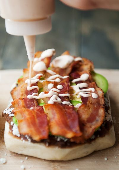 Breakfast torta with refritos, BACON, avocado, cheese, egg, and chipotle mayonnaise. ~~I would so eat this without the egg!