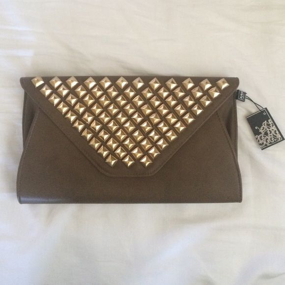 Studded Oversized Clutch Brown oversized clutch with gold studded detail. Never been worn! Feels and looks expensive! Gold chain can be hidden inside clutch. A lot of room inside! MMS Design Studio Bags Clutches & Wristlets