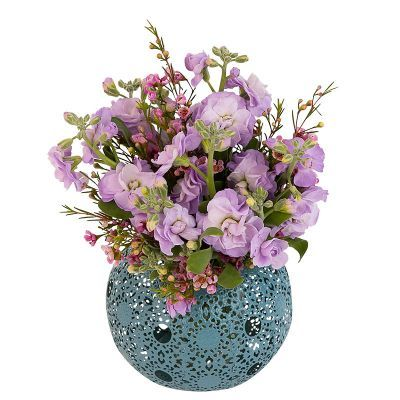 Sweet Scents - A simple cluster of sweet-smelling stocks accented with waxflower. The blue metal ball is a decorative tealight holder.