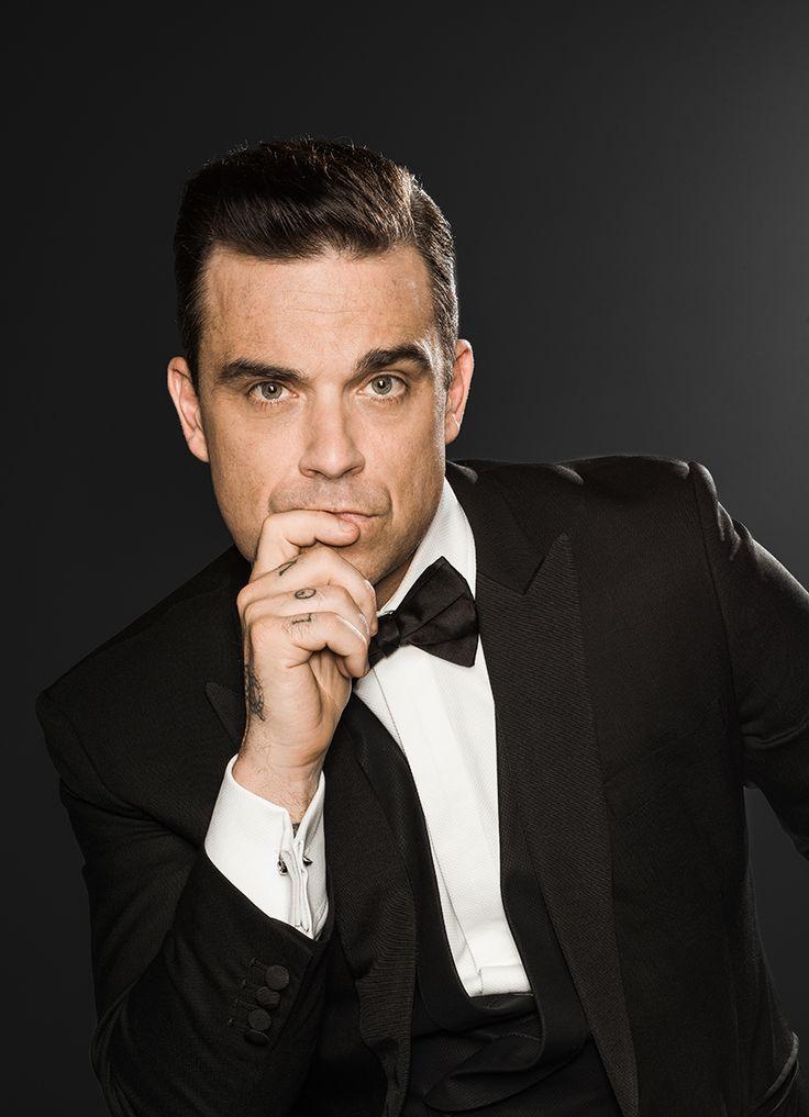 Robbie Williams вопрос 12 - за сумасшествие , эксцентричность, за возможность танцевать, за его красоту