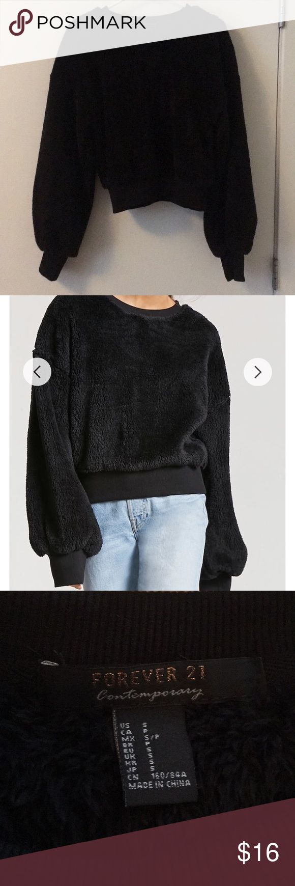 Fuzzy Cropped Sweater INCREDIBLY soft fuzzy sweater! Cropped at the waist and has bell sleeves that cuff. I had to upload the site photo just to show the detail of how soft this thing is! NWOT!  👽 All prices negotiable! 👽 ✨ Bundle and save! ✨ Forever 21 Sweaters