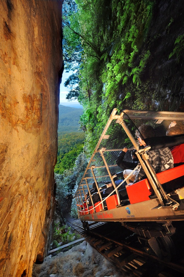 Scenic Railway, Scenic World. Blue Mountains Australia. Looks tame enough. Wrong! Don't be fooled. Note the passenger holding onto the cage above his head.........heart stopper railway with a view to die for.