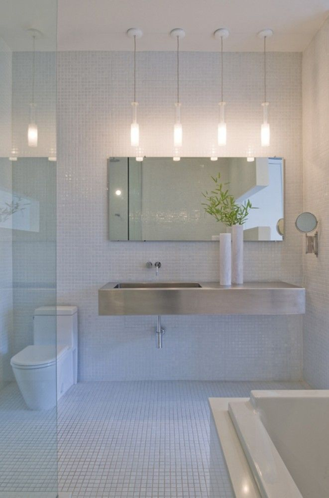Is that a stainless steel sink in a bathroom?? Lovely room anyways, very clean lines, nice lights, a bit of texture from the tiles...