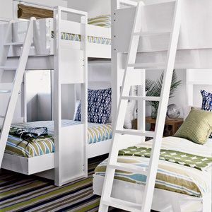 This stylish spin on the classic bunk bed is more sculptural, yet sturdy and compact with plenty of room for sleepovers. Graphic bedding in coastal blues and greens gives the space a calming feel.